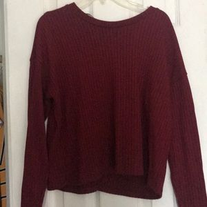 A maroon sweater